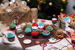 Christmas various gingerbread cookies, cakes, cupcakes. Stock Photo