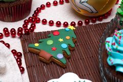 Christmas various gingerbread cookies, cakes, cupcakes. Christmas various gingerbread Christmas decoration with food, cakes, cupcakes, confection. Christmas royalty free stock images