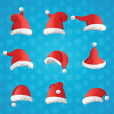 Christmas various hats set in cartoon style on blue background. Collection of Santa Claus headwears. Seamless snowflakes pattern for web background Royalty Free Stock Images
