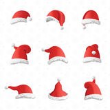 Christmas various hats set in cartoon style on white background. Collection of Santa Claus headwears. Seamless snowflakes pattern for web background Royalty Free Stock Images