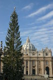 Christmas in Vatican. Saint Peter church with decorated Christmas tree Stock Photo