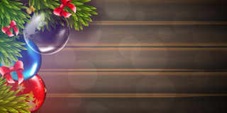 Christmas vector background with fir tree branch and color bulbs on wooden background Stock Photography