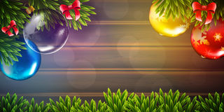 Christmas vector background with fir tree branch and color bulbs on wooden background Stock Images