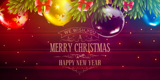 Christmas vector background with fir tree branch and color bulbs on wooden background Royalty Free Stock Photography