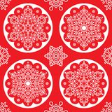 Christmas vector folk pattern - white snowflake mandala seamless design on red, Scandinavian style Xmas wallpaper Stock Photo