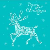 Christmas vector illustration of a reindeer on a blue background. Lettering Merry Christmas. Caligraphy. Snowflakes. New Year. vector illustration