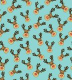 Christmas Vector Seamless Pattern with Deers Faces in Doodle Style Royalty Free Stock Photo