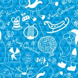 Christmas vector seamless pattern. With thematic doodle elements on blue geometric background Royalty Free Stock Images
