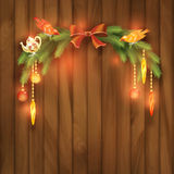 Christmas Vector Tree Branches Decorations Toys. Christmas vector tree branch with toys and decorations on a wooden wall abstract background Royalty Free Stock Images