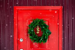 Christmas veins on the red door. Contrast picture stock images