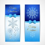 Christmas Vertical Banners. On dark and light blue background with greetings, snowflakes, textile ribbons isolated vector illustration Stock Photography