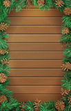 Christmas vertical wooden background with pine branches and cones. Stock Image