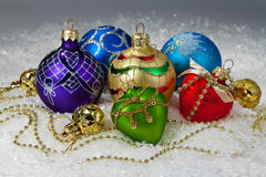 Christmas vibrant decorations on snow Stock Image
