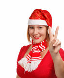 Christmas victory sign. Young woman in new year or christmas suit smiling isolated on white background with victory sign Stock Photos