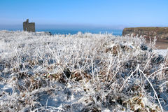 Christmas view of ballybunion castle and beach. A seasonal snow covered view of atlantic ocean and ballybunion castle beach and cliffs on a frosty snow covered Royalty Free Stock Image