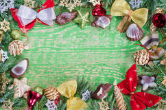 Christmas vignette on a green wooden background, plenty of space for labeling. Stock Photos