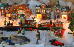 Christmas Village Figurines. Christmas figurines from a holiday village display Stock Image