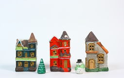 Christmas Village On White. Three small ceramic Christmas houses photographed against a light background Stock Image