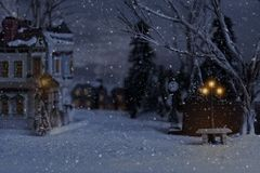 Free Christmas Village With Bench And Lantern Stock Images - 131310394