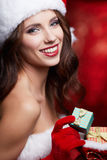 Christmas vintage brunette with gift box, isolated on grey. Fash Stock Images