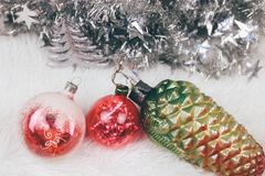 Christmas vintage toys with baubles on white texture. Top view. royalty free stock photo
