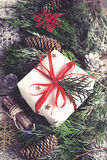 Christmas Vintage card.  Festive Gift box, coniferous branches a Stock Photos