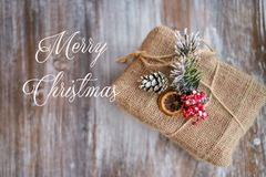 Christmas vintage card. The inscription Merry Christmas. Christmas gift on vintage wooden background. Top view, flat lay, copy spa. Christmas vintage card. The Stock Images