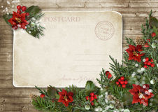 Christmas vintage card with poinsettia, holly and fir branches Stock Image