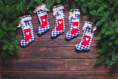 Christmas vintage decor. Blue gingham booties on the wooden table with copy space Stock Photo