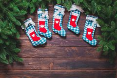 Christmas vintage decor. Blue gingham booties on the wooden table with copy space Stock Photography
