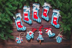 Christmas vintage decor. Blue gingham toys on the wooden table Stock Image