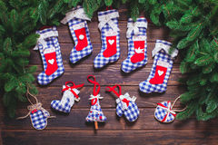 Christmas vintage decor. Blue gingham toys on the wooden table Stock Photo