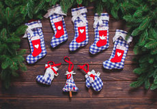 Christmas vintage decor. Blue gingham toys on the wooden table Stock Images
