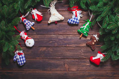 Christmas vintage decor. Blue gingham toys on the wooden table with copy space Stock Photos