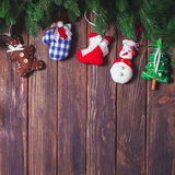 Christmas vintage decor. Blue gingham toys on the wooden table with copy space Royalty Free Stock Photos