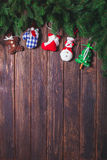 Christmas vintage decor. Blue gingham toys on the wooden table with copy space Stock Images
