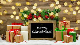 Christmas vintage decoration burning candles gift boxes lights Royalty Free Stock Photo