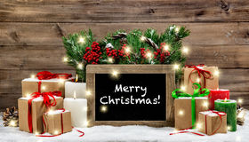 Christmas vintage decoration burning candles gift boxes lights Royalty Free Stock Images