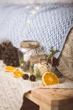 Vintage christmas interior decoration elements. Christmas vintage decoration elements with jars, candles ,oranges and cones on a blanket Stock Photo