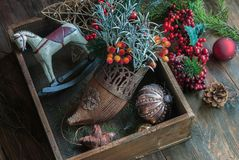 Christmas vintage decorations. In a wooden box Retro decora, top view, flat lay royalty free stock photo