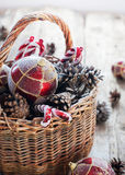 Christmas Vintage Gifts in Basket, Red Gold balls, Pine cones Stock Image