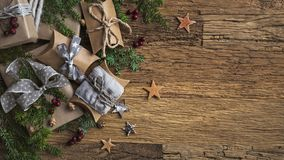Christmas vintage gifts. On a wooden background stock photos