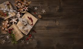 Christmas vintage gifts. On a wooden background royalty free stock photography