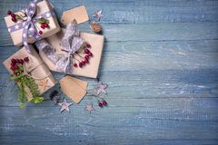 Christmas vintage gifts. On a wooden background stock photo