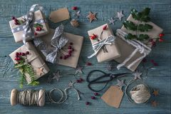 Christmas vintage gifts. On a wooden background stock photography