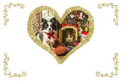 Christmas dog vintage greeting card. Christmas vintage greeting card. Golden heart with Baby Jesus and dog inside, isolated on white background Royalty Free Stock Photos