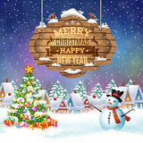 Christmas vintage greeting card on winter village. Christmas and happy new year vintage greeting card on winter village. Christmas signboard and Winter landscape Royalty Free Stock Photo