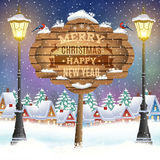 Christmas vintage greeting card on winter village. Christmas and happy new year vintage greeting card on winter village. Christmas signboard and Winter landscape Stock Photo