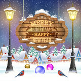 Christmas vintage greeting card on winter village. Christmas and happy new year vintage greeting card on winter village. Christmas signboard and Winter landscape Stock Photos