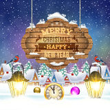 Christmas vintage greeting card on winter village. Meryy Christmas and happy new year vintage greeting card on winter village. Christmas signboard and Winter Stock Photography